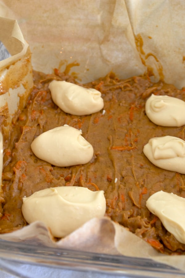 Add cream cheese to carrot cake batter.