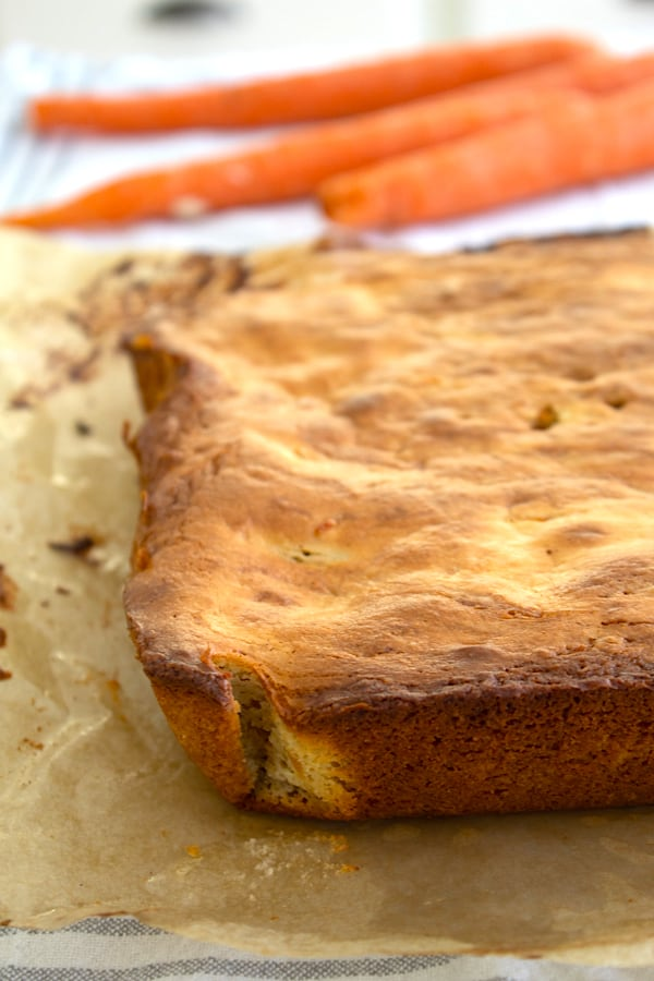 carrot cake bars fresh out of the oven on parchment
