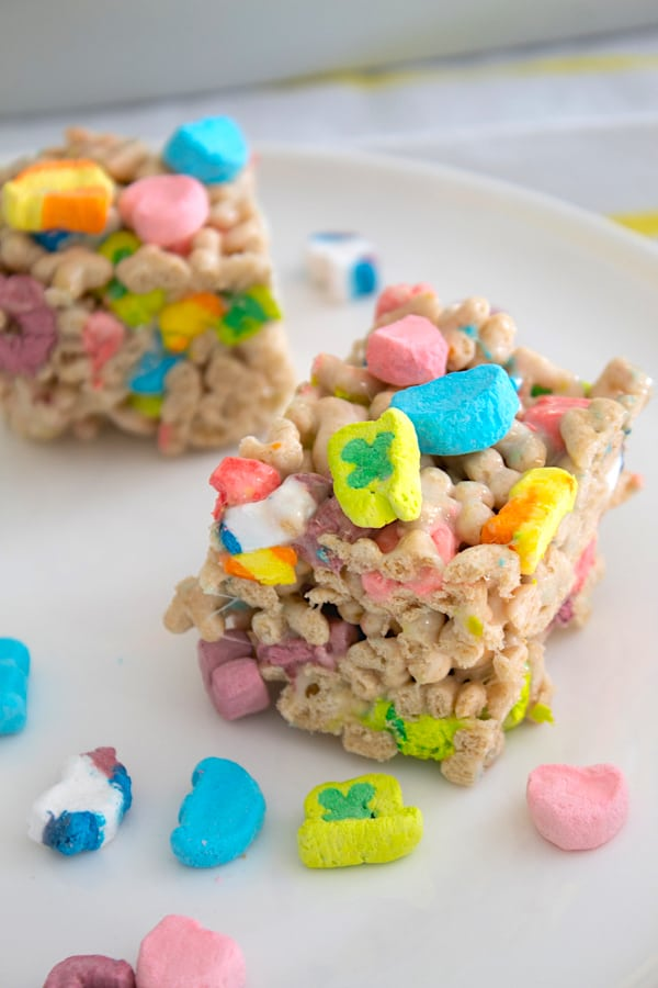 marshmallow cereal bars with lucky charms on platter