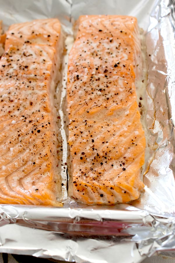 2 salmon filets cooked on a sheet pan with salt and pepper