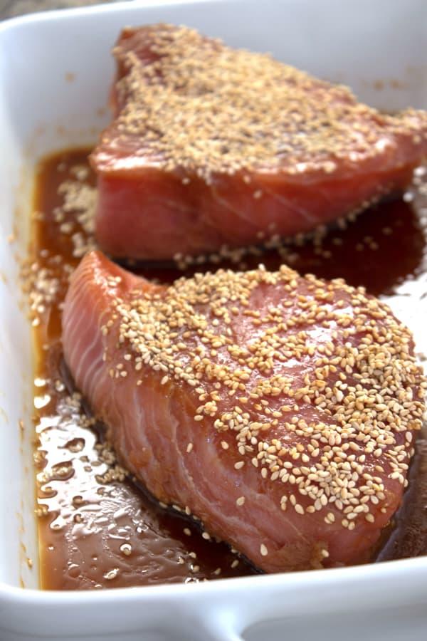 marinating 2 ahi steaks in a casserole dish