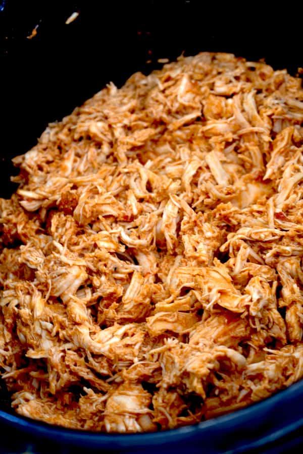 slow cooker full of shredded chicken taco meat
