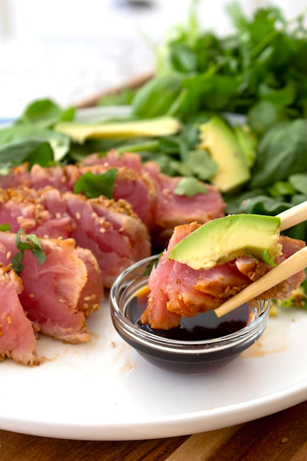 serving seared ahi tuna with avocado and soy sauce
