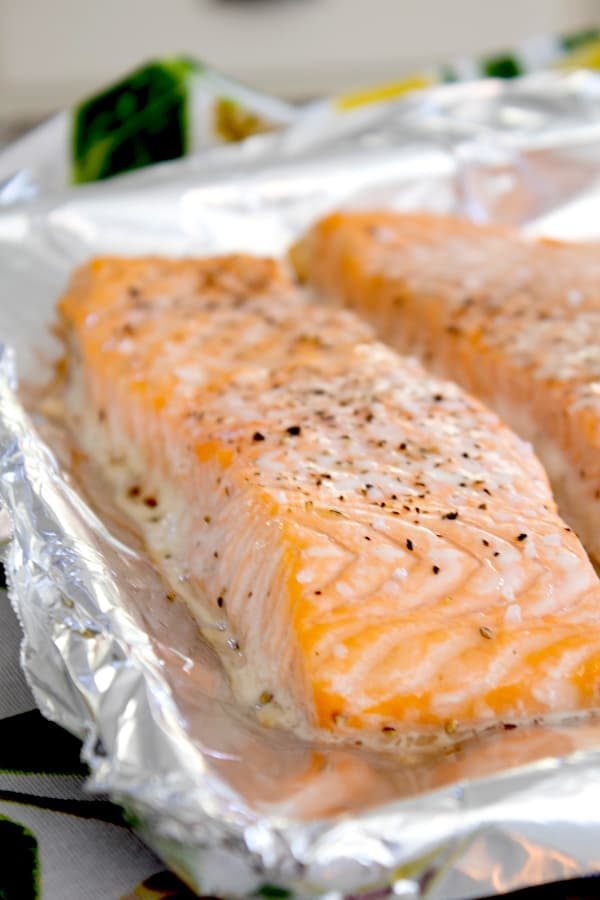 side view of cooked salmon filet on a sheet pan