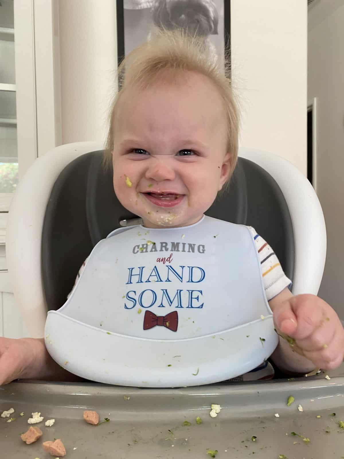 picture of Benny in high chair with bib
