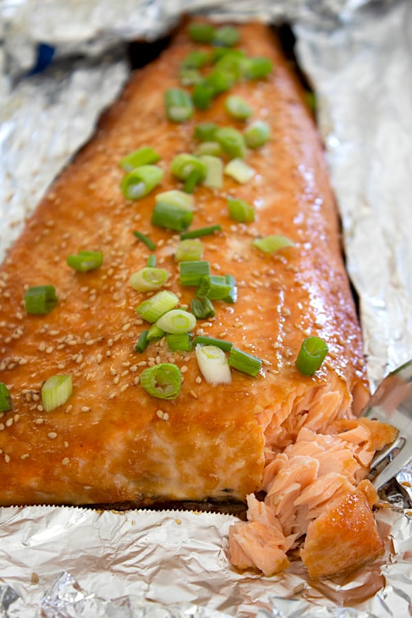 view of miso salmon on foil sheet pan with bite taken out