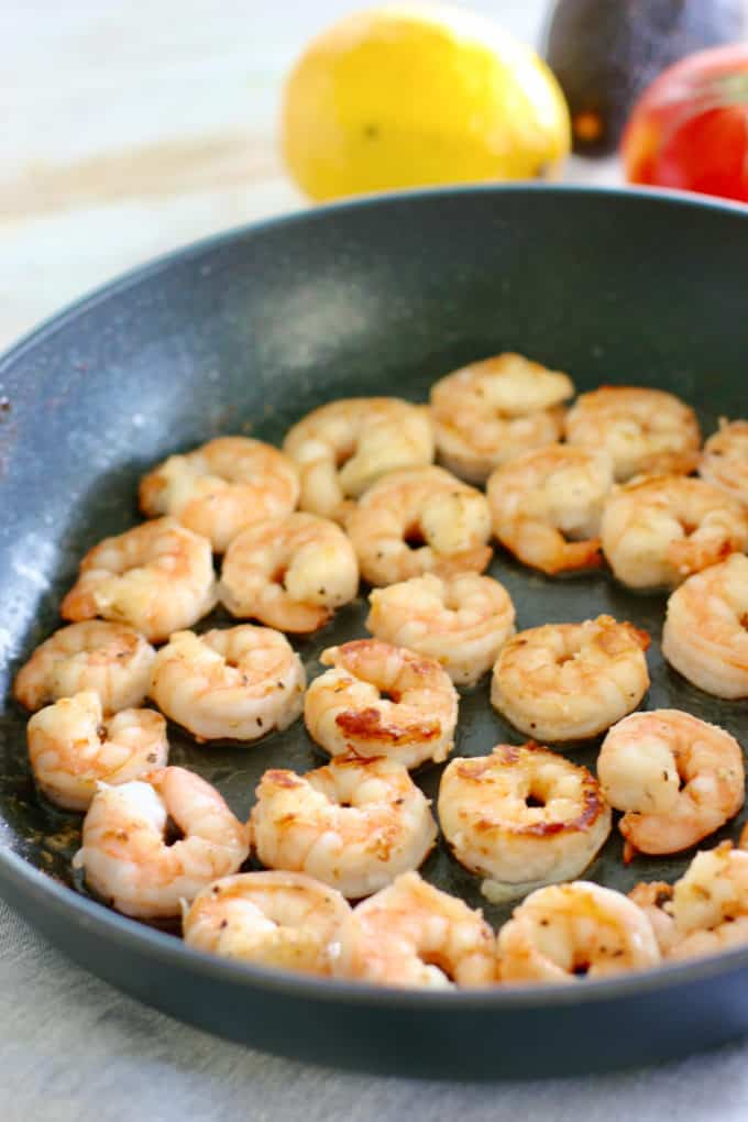 shrimp in a frying pan after being seared.