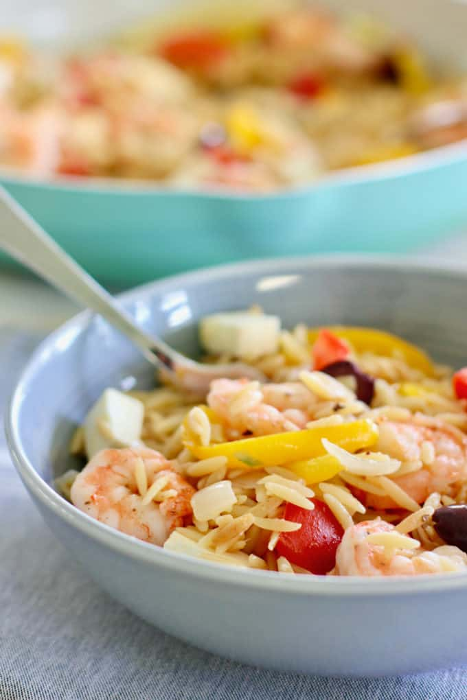 Meditteranean Shrimp and Orzo in a gray bowl ready to eat