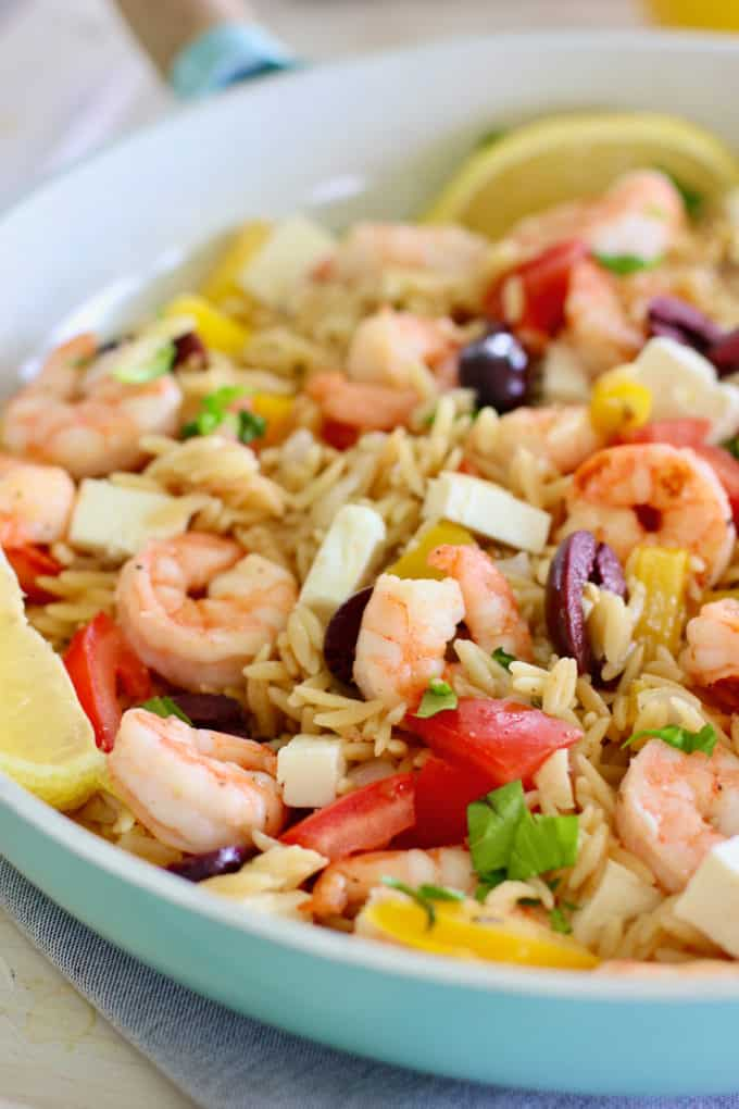 shrimp skillet dinner with orzo in a blue pan