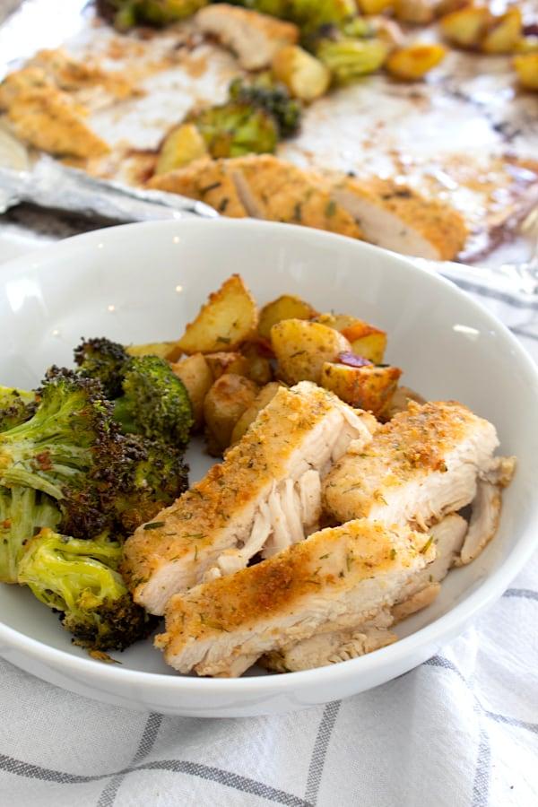 white ceramic bowl with chicken dinner inside