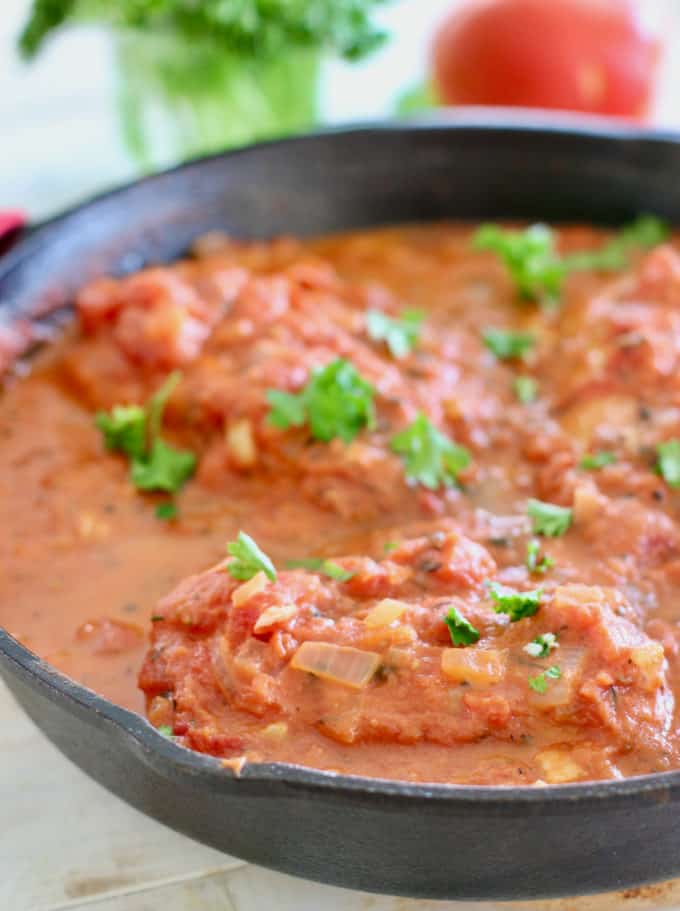 Fish in tomato sauce in a skillet