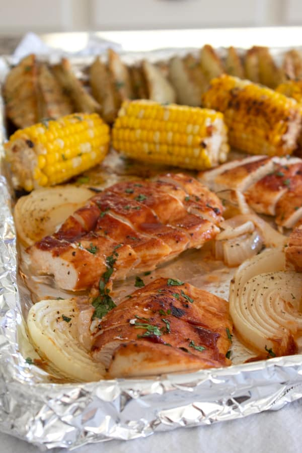 chicken corn and potatoes on a sheet pan