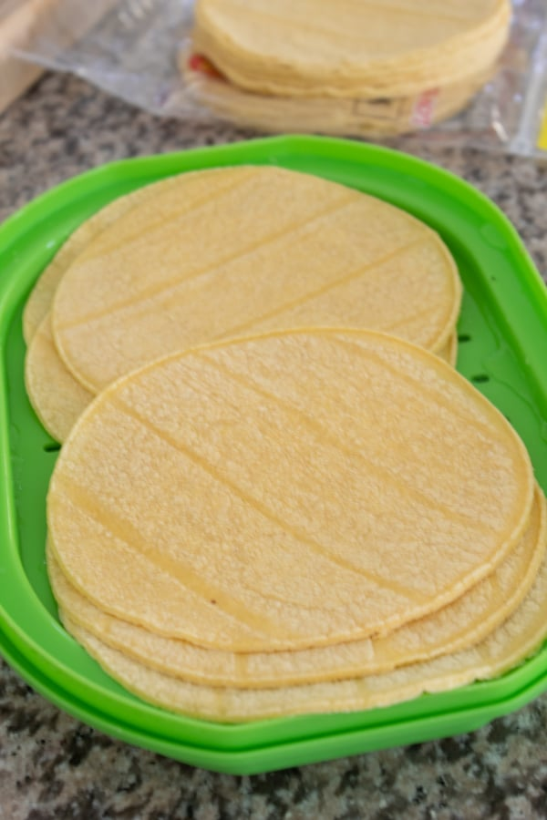 steaming corn tortillas