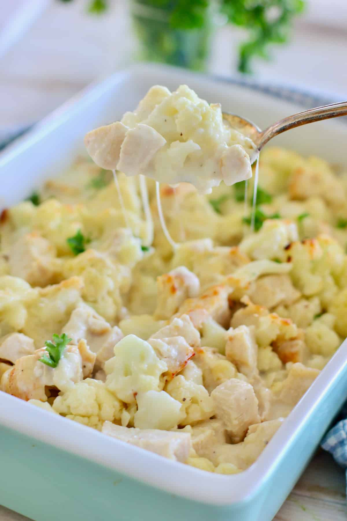 cauliflower casserole in a white baking dish
