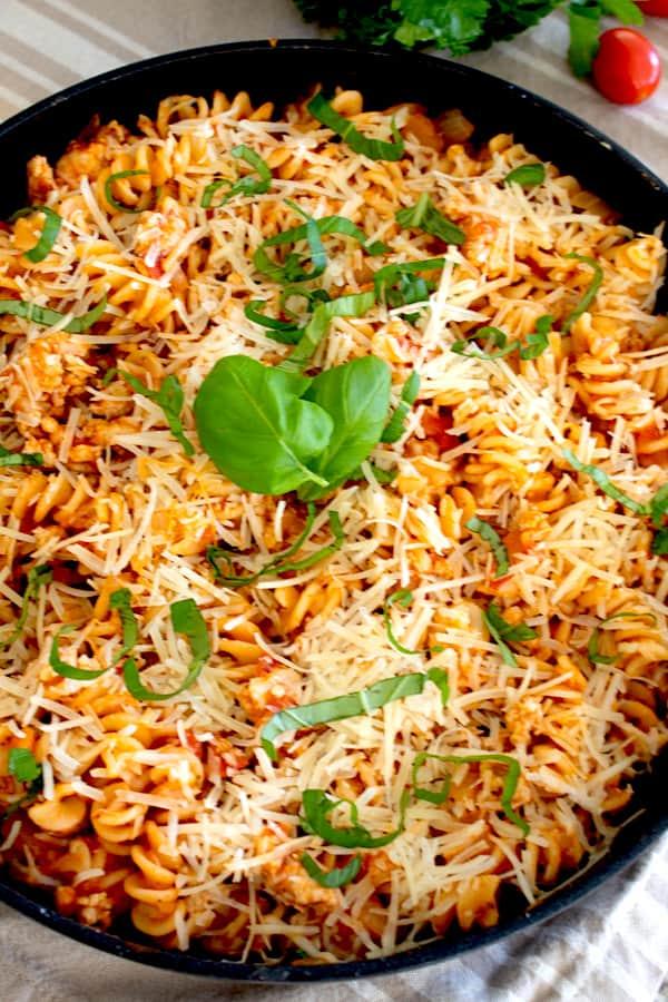 overhead shot of ground chicken pasta skillet
